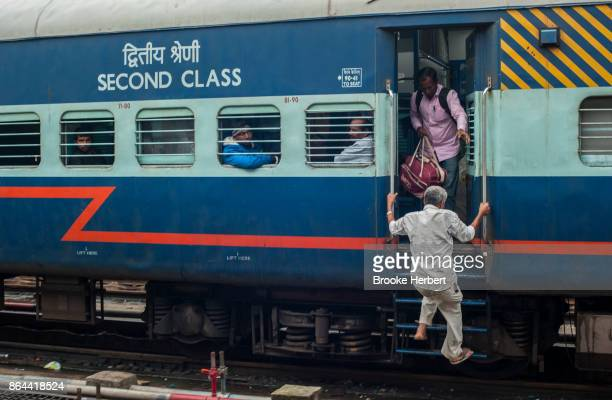Passengers rush to board an Indian Railways train car that arrived late on Monday during Diwali week on October 16 in Bangalore India Diwali the...