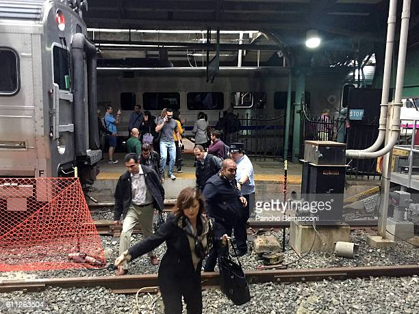 Passengers rush to safety after a NJ Transit train crashed in to the platform at the Hoboken Terminal September 29 2016 in Hoboken New JerseyNew...
