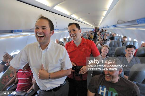 USA Passengers Scott Steinbaugh left and Matt Town laugh as comedian and 'air hostess' Pam Ann give the flight crew a hard time during JetBlue's...