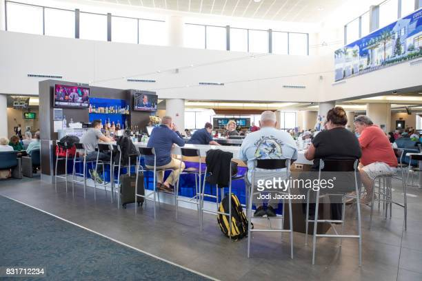 Passengers seated at bar in Palm Beach International Airport