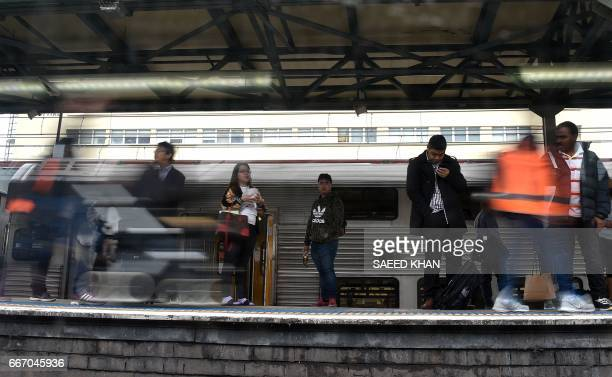 Passengers seen through a train window wait on the platform in central business district of Sydney on April 11 2017 Thousands of passengers use...
