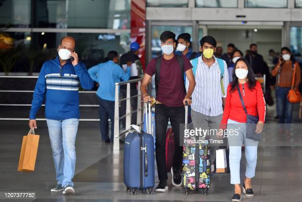 Passengers seen wearing face masks as a preventive measure against the spread of coronavirus at Indira Gandhi International Airport on March 16 2020...