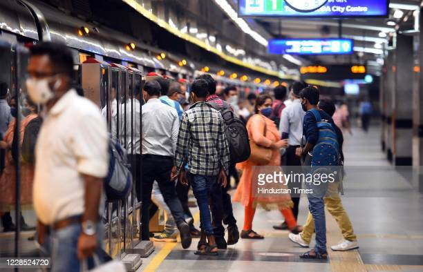 Passengers seen wearing masks while using metro services during Unlock 4 at Rajiv Chowk metro station on September 14 2020 in New Delhi India