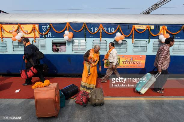 Passengers seen with their bags outside the newly launched tourist train 'Ramayana Express' by Indian Railway Catering and Tourism Corporation from...