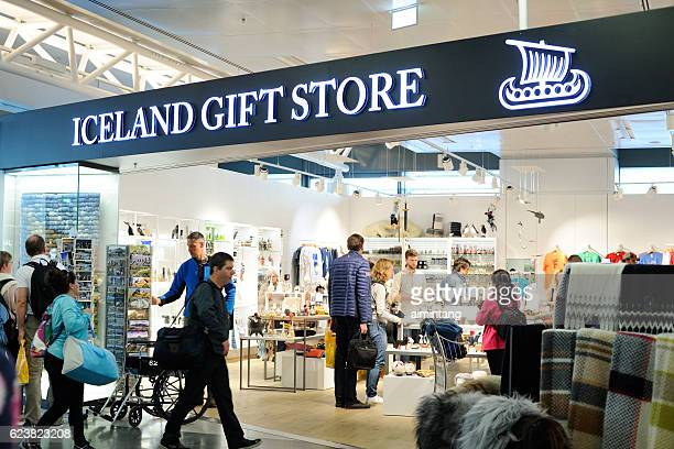 passengers shopping at keflavik international airport - gift shop stock photos and pictures