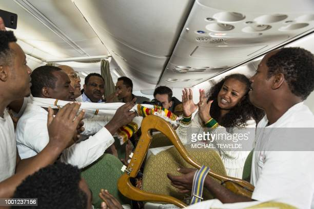 Passengers sing and dance on July 18 during the first flight between the Ethiopian capital Addis Ababa and the Eritrean capital Asmara in twenty...