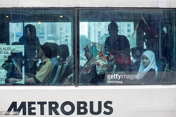 Passengers sit in a bus operated by Metrobus Nationwide Sdn. Bhd. In Kuala Lumpur, Malaysia, on Tuesday, March 18, 2014. Malaysia, aspiring to become...