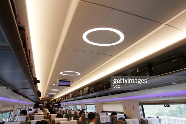 Passengers sit in a second class wagon of China's new high speed train 'Fuxing' during its first route from Beijing to Shanghai on June 26 2017 in...
