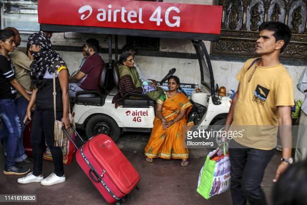 Passengers sit on a cart at the Bhubaneshwar Railway Station after Cyclone Fani passes in Bhubaneshwar Odisha India on Sunday May 5 2019 Authorities...