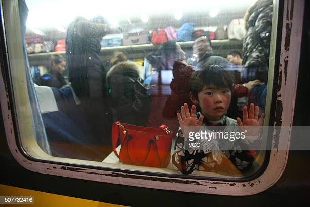 Passengers sit on a train for home at Ningbo Railway Station on January 30, 2016 in Ningbo, Zhejiang Province of China. As Chinese traditional Spring...