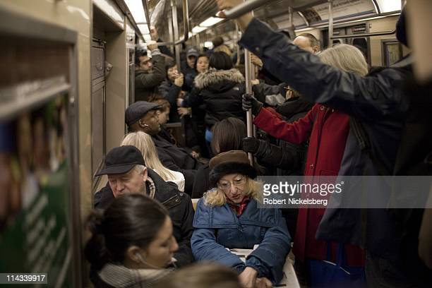 Passengers sit on the subway March 12, 2011 in New York, New York. In 2009, the New York City Subway delivered nearly 1.6 billion rides, averaging 5...