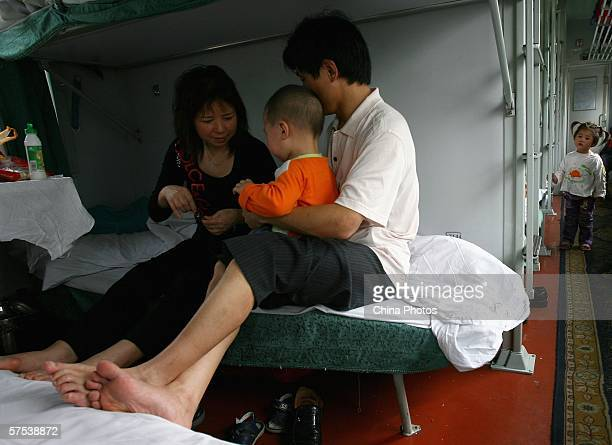 Passengers sit on their bed on a train bound for Xiamen from Chongqing on May 4 2006 in Chongqing Municipality China The Chinese government expects a...