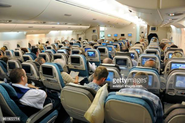 Passengers sitting in the economyclass cabin seats of a Singapore Airlines SIA Airbus A380800 enroute SINLHR flightnumber SQ322