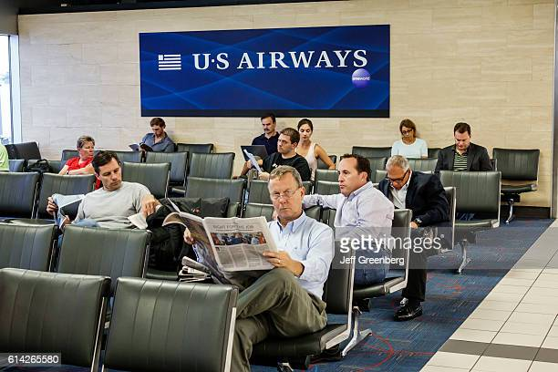 Passengers sitting in US Airways airline gate area in LambertSt Louis International Airport
