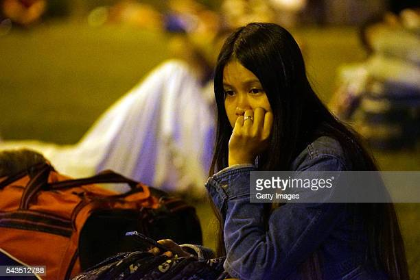 Passengers sleep outside of Turkey's largest airport Istanbul Ataturk after the suicide bomb attack in the early hours of June 29 Turkey Three...