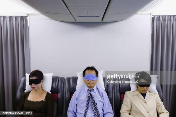 Passengers sleeping in an airplane