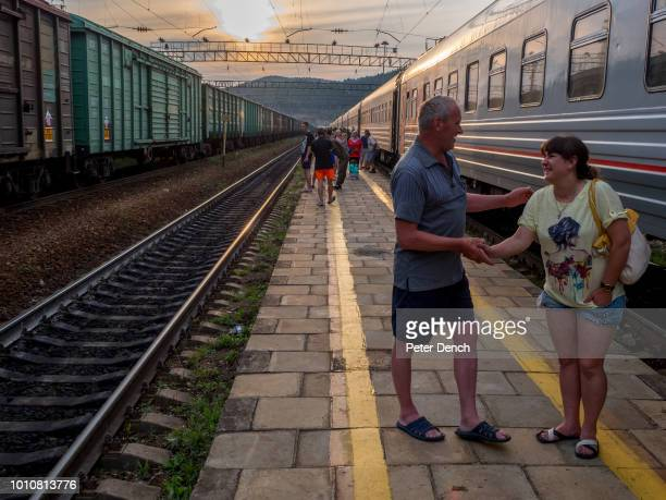 Passengers socialize and stretch their legs during a scheduled stop on the TransSiberian Railway from MoscowVladivostok Spanning a length of 9289km...