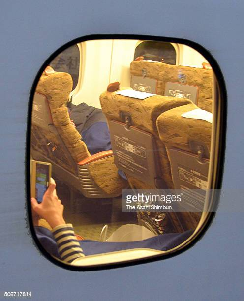 Passengers spend a night in the Shinkansen carriage as the service suspended at Okayama Station on January 25 2016 in Okayama Japan this winter's...