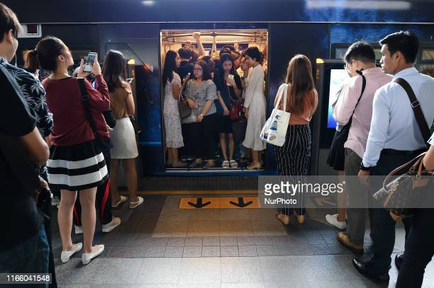 Passengers stand at a carriage door while travelling aboard a BTS skytrain in Bangkok, Thailand. 05 September 2019.