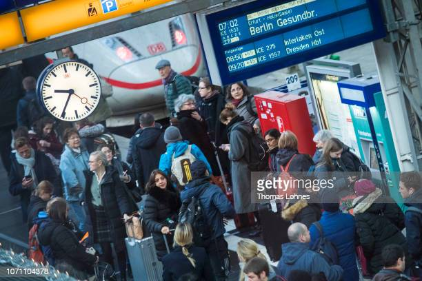 Passengers stand at a rail track shortly after a strike by Deutsche Bahn workers on December 10 2018 in Frankfurt/Main Germany The strike launched by...
