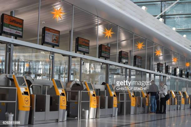 Passengers stand in front of the Lufthansa self service desks during a strike of pilots of the German airline Lufthansa at the Lufthansa terminal of...