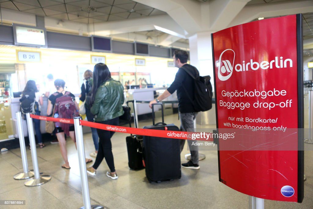 Passengers stand in line to check baggage for an Air Berlin flight at Tegel Airport (TXL) on August 23, 2017 in Berlin, Germany. Air Berlin's creditors are meeting to discuss acquisition of the insolvent carrier's assets. The airline has been in talks with interested parties since last week after filing for bankrupty when its major shareholder, Etihad, backed out of its funding. Lufthansa, also interested in Air Berlin's Austrian subsidy Niki, Thomas Cook, easyJet and Ryanair are all said to be participating in discussions.