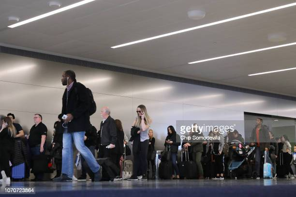Passengers stand in line waiting to board a flight to Las Vegas at John F Kennedy Airport on the day before the Thanksgiving holiday November 21 2018...