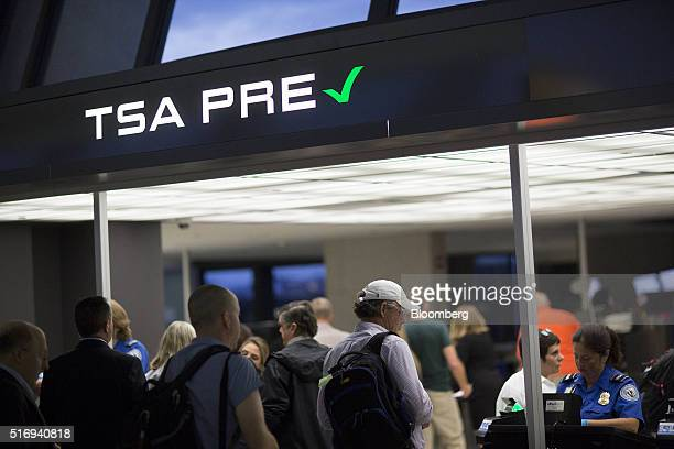 Passengers stand in the Transportation Security Administration precheck line at Dulles International Airport in Dulles Virginia US on Wednesday Aug...