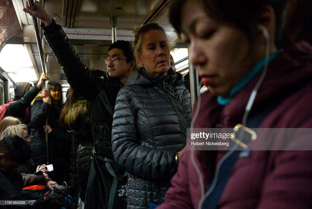 Riders On New York City Subways : News Photo