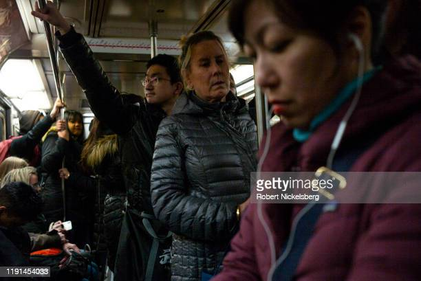 Passengers stand on a downtown subway car in New York City, November 23, 2019. Approximately 4.3 million people ride the New York City subway system...