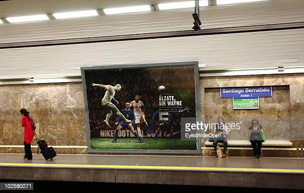 Passengers stand on the platform of the Santiago Bernabeu metro station on May 21 2010 in Madrid Spain Madrid is a big european city with more than 3...