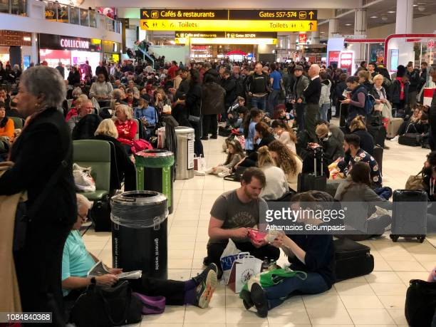 Passengers stranded at Gatwick waited for updates on their travel options on December 20 2018 in London England Authorities at Gatwick closed the...