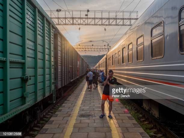 Passengers stretch their legs during a scheduled stop on the TransSiberian Railway from MoscowVladivostok Spanning a length of 9289km ist' the...