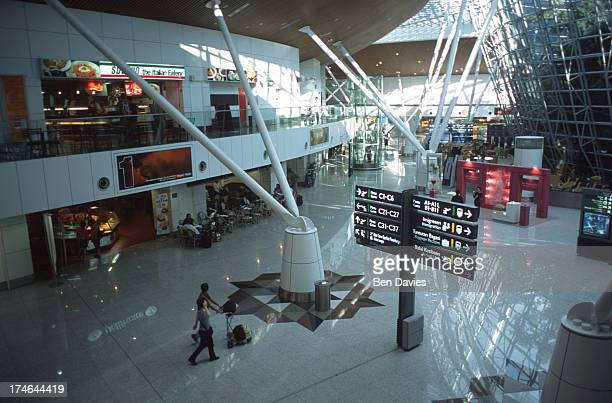 Passengers stroll through the spectacular departure and arrival hall at the new Kuala Lumpur International Airport in Malaysia A project of former...