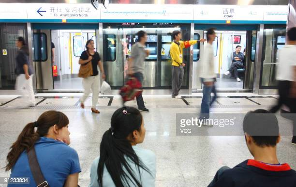 Passengers take the new subway line Line 4 on September 28 2009 in Beijing China With a total length of 282 km Subway Line 4 runs through Beijing's...