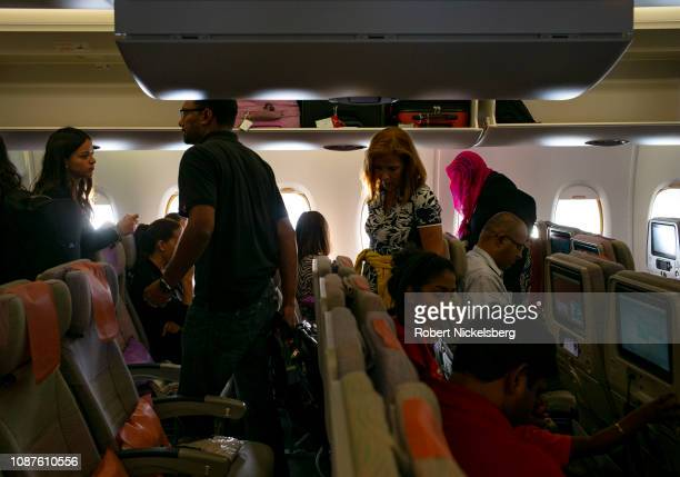 Passengers take their seats on an Emirates Airways jet plane ready to depart for New York City in Dubai United Arab Emirates on September 25 2016