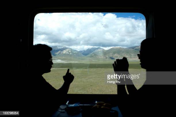 Passengers talk in a train carriage of from Beijing to Lhasa on August 15 2012 in Damxung China After QinghaiTibet Railway went into operation on...