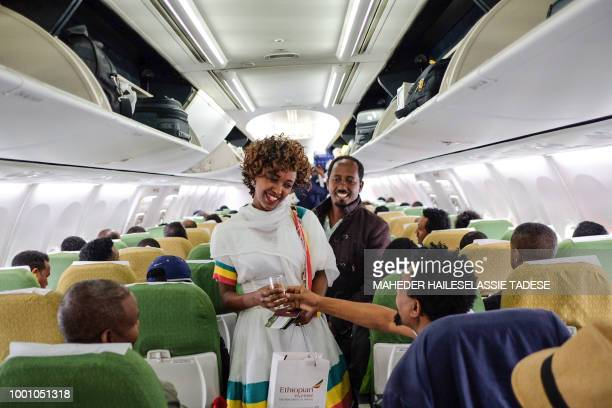 TOPSHOT Passengers talk inside an Ethiopian Airlines flight who departed from the Bole International Airport in Addis Ababa Ethiopia to Eritrea's...