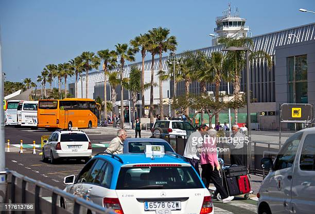 Passengers taxis and cars outside of the Airport Reina Sofia on March 25 2011 in Tenerife Spain Tenerife is the biggest of the canary islands and...