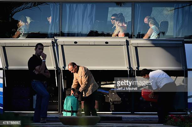 Passengers thought to be British leave the Imperial Marhaba Hotel where 38 people were killed yesterday in a terrorist attack on June 27 2015 in...