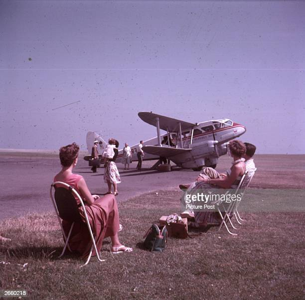 Passengers to the Scilly Isles wait to board the De Havilland Land Dragon Rapide still in use for short flights Original Publication Picture Post...