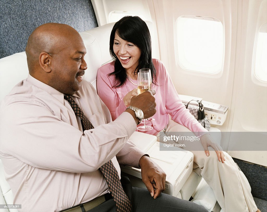 Passengers Toasting With Champagne in an Aircraft Cabin Interior : Stock Photo