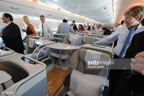 Passengers tour the business class seat aboard an Emirates Airlines Airbus A380 during a twohour familiarization flight over the coast of Southern...