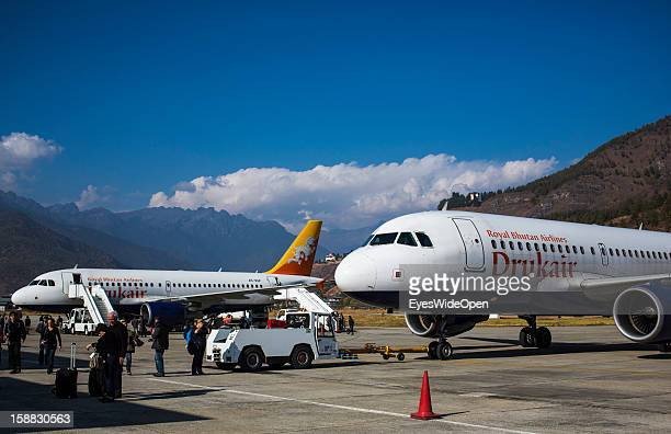 Passengers, tourists arrived with an aeroplane of the Royal Bhutan Airline Drukair at Paro Airport , one of the most dangerous airports in the world...
