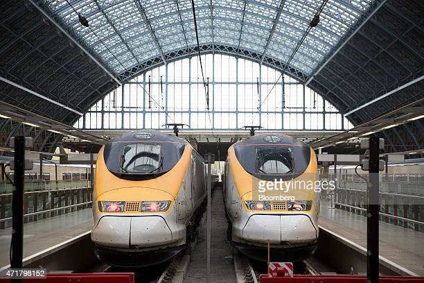 Passengers trains operated by Eurostar International Ltd sit beside railway platforms St Pancras International station in London UK on Friday May 1...