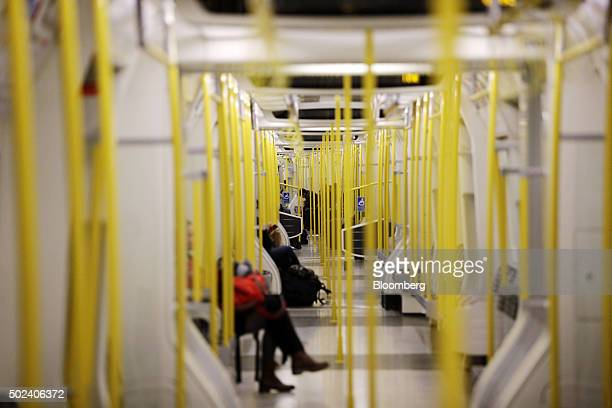 Passengers travel on a Circle Line underground railway train in London UK on Thursday Dec 24 2015 UK stocks were little changed after yesterday's...