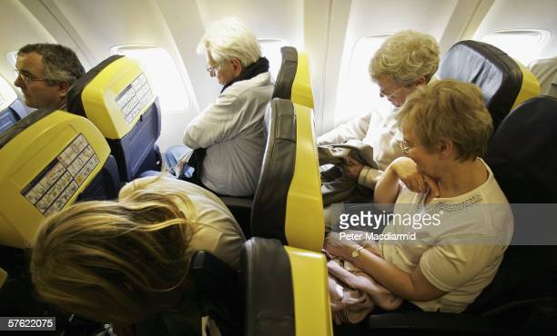 Passengers travel on a low cost flight to Dinard in France on May 15 2006 from London Low cost airlines are increasing their market share in Europe...