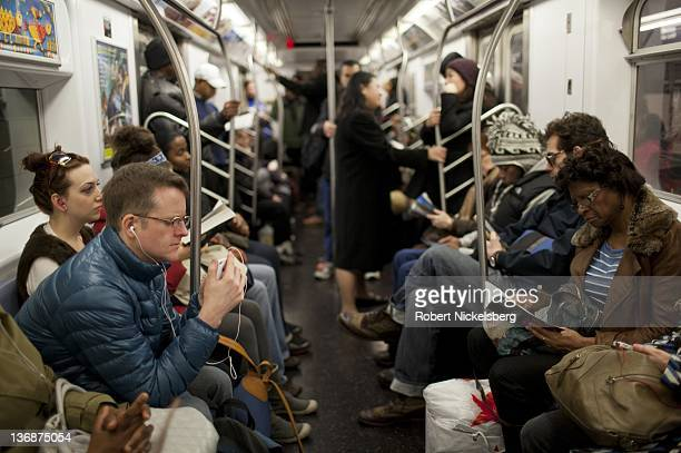 Passengers travel on a New York City subway January 7 2012 In 2010 New York's subway system delivered over 16 billion rides averaging 5 million rides...