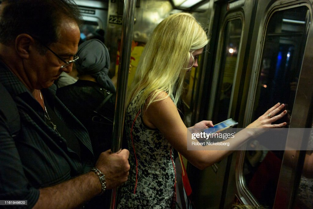 Riders On New York City Subways : News Photo