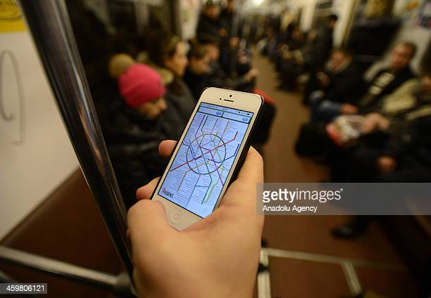Passengers travel on Moscow Metro train on December 28 in Moscow One of the largest underground metro system in the world the Moscow Metro daily...